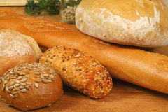 Fresh bread - different kinds. Different kinds of fresh bread on wooden board Royalty Free Stock Image