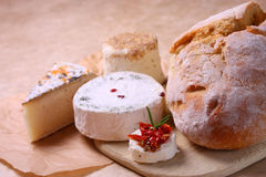 Fresh bread and different sorts of cheese Royalty Free Stock Photography