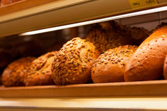 Fresh bread in the display of a bakery Royalty Free Stock Images