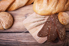 Fresh bread and ears of ripe wheat Royalty Free Stock Image