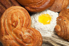 Fresh bread with ears of rye and flour Royalty Free Stock Image