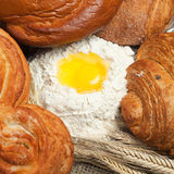 Fresh bread with ears of rye and flour Stock Photo