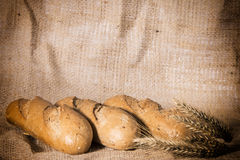 Fresh bread with ears of rye Royalty Free Stock Photos