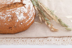 Fresh bread with ears on the table Stock Photo