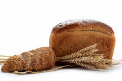 Fresh bread with ears of whea. Fresh bread with ears of wheat on the canvas Stock Images