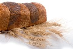 Fresh bread with ears of wheat Royalty Free Stock Image