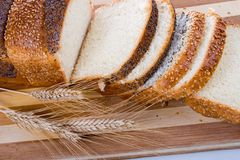 Fresh bread with ears of wheat Royalty Free Stock Images