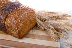 Fresh bread with ears of wheat Stock Photography