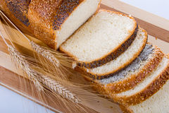 Fresh bread with ears of wheat Royalty Free Stock Photos