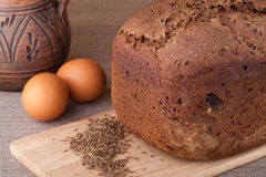 Fresh bread with eggs and cumin. On the table Royalty Free Stock Photo