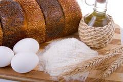 Fresh bread,  eggs,  flour  and  oil Stock Photography