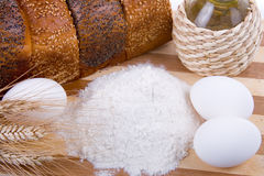 Fresh bread,  eggs,  flour  and  oil Royalty Free Stock Photos