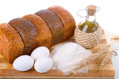 Fresh bread,  eggs,  flour  and  oil Royalty Free Stock Photography