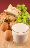Fresh bread with eggs  and glass of milk Royalty Free Stock Photography