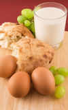 Fresh bread with eggs and glass of milk Royalty Free Stock Image