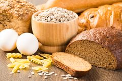 Fresh bread, eggs, pasta and grains Stock Photos