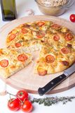 Fresh bread focaccio with tomatoes, cheese brynza, garlic and thyme Stock Image