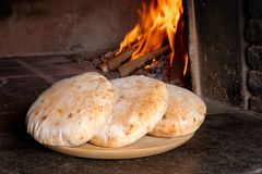 Fresh bread in front of the oven Stock Images