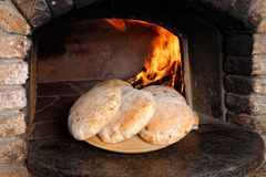 Fresh bread in front of the oven Royalty Free Stock Images