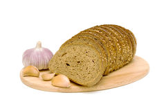 Fresh bread and garlic on a white background Stock Photography