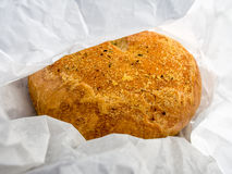 Fresh Bread. Garlic bread in the white paper bag Stock Photos