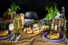 Fresh bread and homemade butter on decorated Royalty Free Stock Images