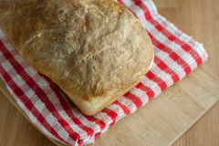 Fresh Bread. Fresh homemade bread sits cooling on a table Royalty Free Stock Image