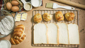 Fresh bread and ingredients on wood table with space. Top view Royalty Free Stock Photography