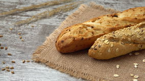 Fresh bread on the kitchen table. Healthy eating and traditional bakery concept. Prores 4K. stock footage