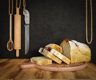 Fresh bread with oat sliced on a slate cutting board photo background copy space Royalty Free Stock Photo