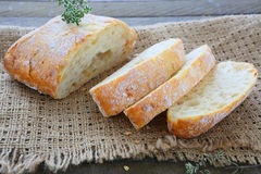 Fresh bread on old sacking Royalty Free Stock Image