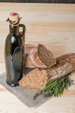 Fresh bread with olive oil and rosemary Royalty Free Stock Photography