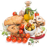 Fresh bread with olives, tomatoes, spices and olive oil Stock Photos