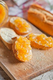 Fresh bread with orange jam Royalty Free Stock Photo