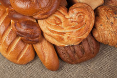 Fresh bread over sacking background Stock Photo