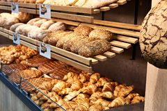 Fresh bread and pastries in bakery stock image