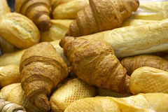 Fresh bread and a pastry. Full basket fresh bread and a pastry of golden color Royalty Free Stock Images