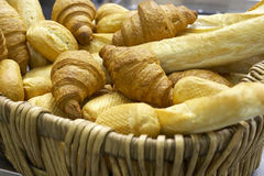 Fresh bread and a pastry. Full basket fresh bread and a pastry of golden color Royalty Free Stock Photos