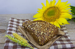 Fresh bread. Pieces of bread with sunflower seeds. Loaf of whole Royalty Free Stock Images