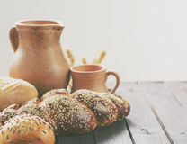 Fresh bread with pottery on a wooden table. Royalty Free Stock Photo