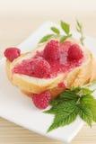 Fresh bread with raspberry jam. Tasty breakfast Stock Image