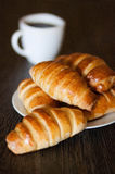 Fresh bread rolls. Board bun coffee cup dessert food Royalty Free Stock Photos