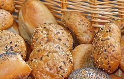 Fresh bread rolls or buns in a basket stock photo