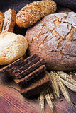 Fresh bread and rolls with ears of wheat Stock Image