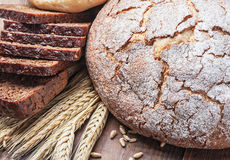 Fresh bread and rolls with ears of wheat Stock Images