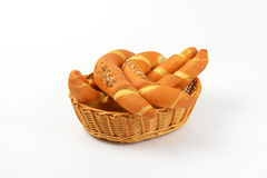 Fresh bread rolls. Scuttle of fresh bread rolls on white background Stock Image