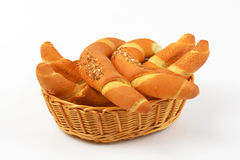 Fresh bread rolls. Scuttle of fresh bread rolls on white background - close up Royalty Free Stock Image