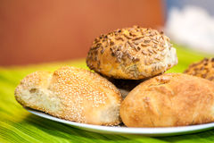 Fresh bread rolls with sunflower and sesame seeds Royalty Free Stock Photos