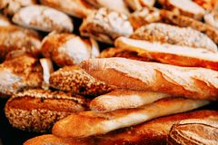 Fresh bread and rolls. Fresh bread and wheat on the wooden royalty free stock photography
