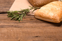Fresh bread. Rustic bread and wheat on an old vintage planked wood table Royalty Free Stock Photos